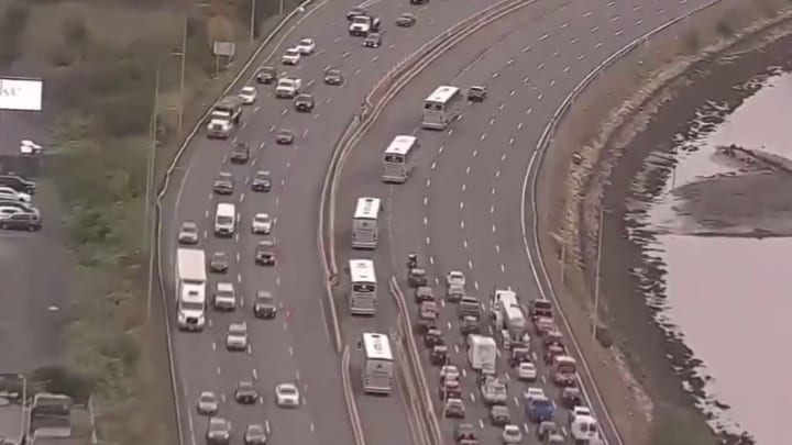 Patriots team buses mess up the morning commute.