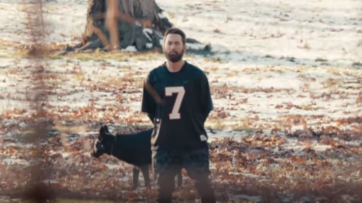 Eminem in a Michael Vick jersey.