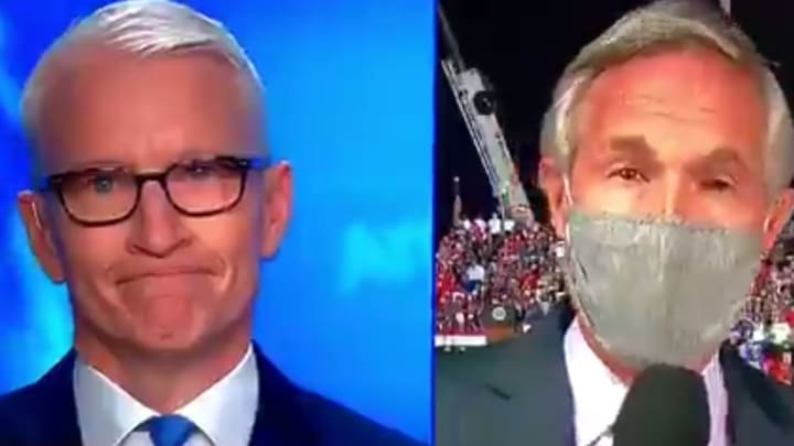 """Anderson Cooper listens to """"Macho Man."""""""