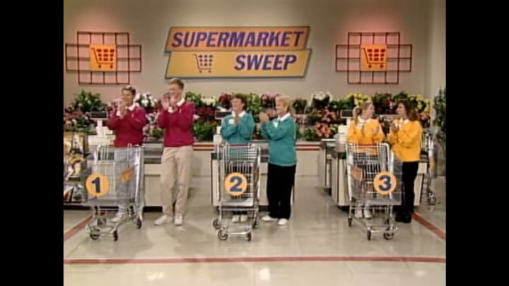 Supermarket Sweep contestants all dressed up.