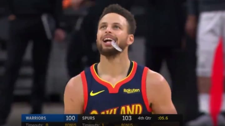 Stephen Curry reacts to Draymond Green's three point attempt.