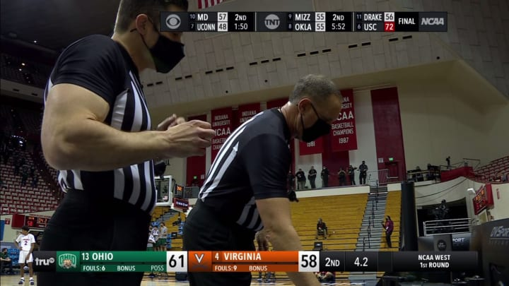 Officials review a call in the Ohio - Virginia game.