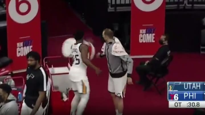 Donovan Mitchell knocking over a cooler.