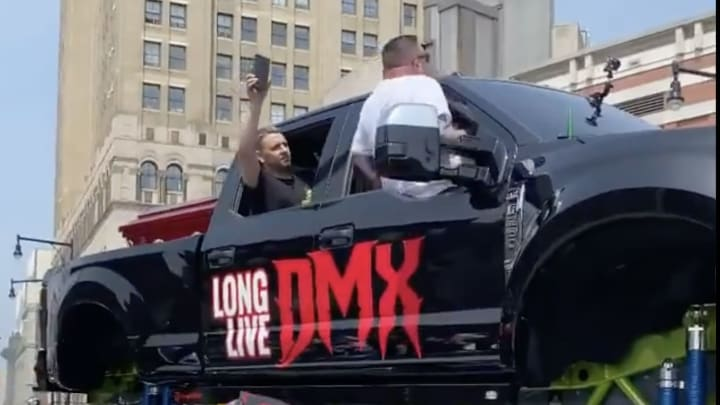 DMX's casket on a monster truck