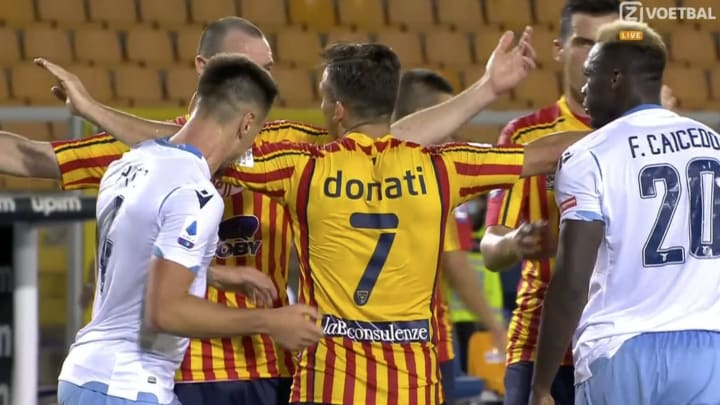 Lazio's Patric bites Lecce's Giulio Donati