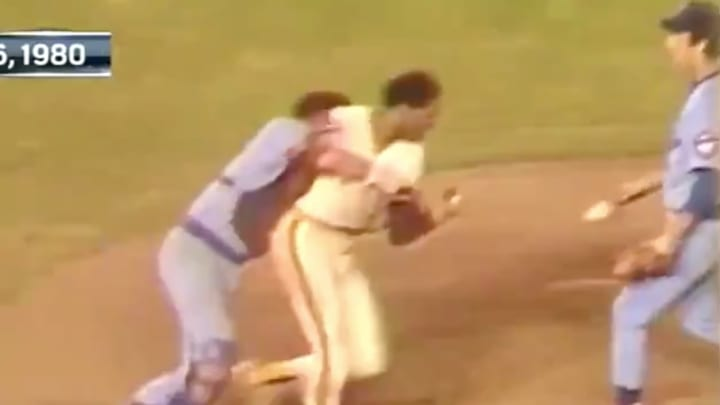 Hall of Fame outfielder Dave Winfield getting tackled by Cubs catcher Barry Foote