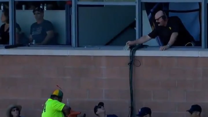 Padres broadcaster Mark Grant gets a churro at spring training