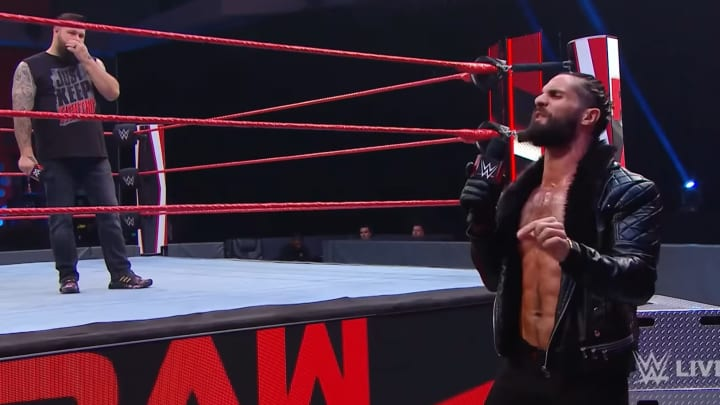 Seth Rollins cuts a promo in front of Kevin Owens on WWE Raw