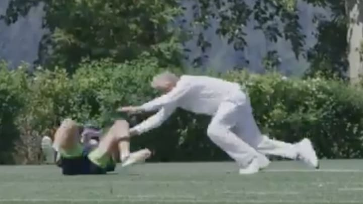 Pete Carroll diving on a fumble.