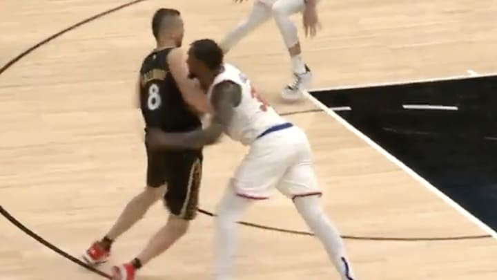 Julius Randle gets in a cheap shot on Gallo.