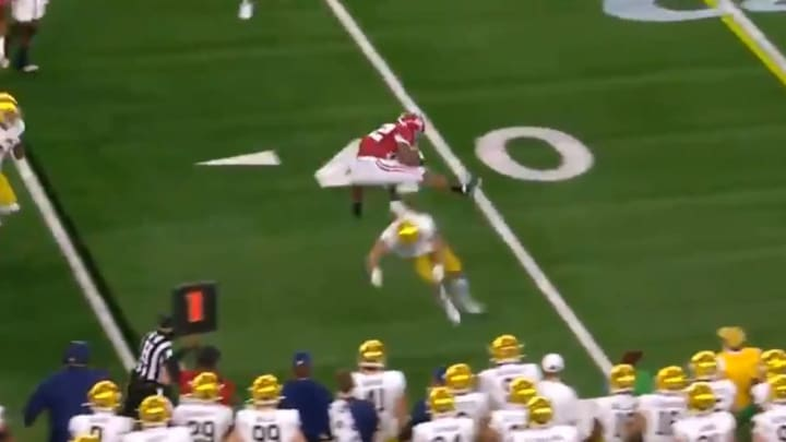 Najee Harris hurdles a Notre Dame defender during the Rose Bowl