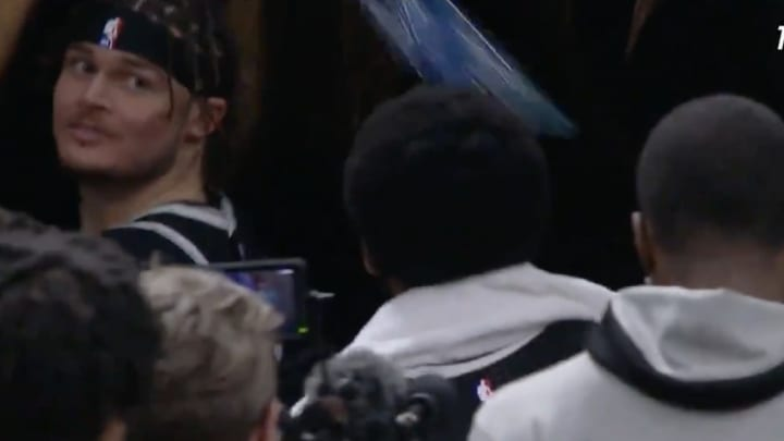 Tyler Johnson watches Kyrie Irving almost get hit with a water bottle.