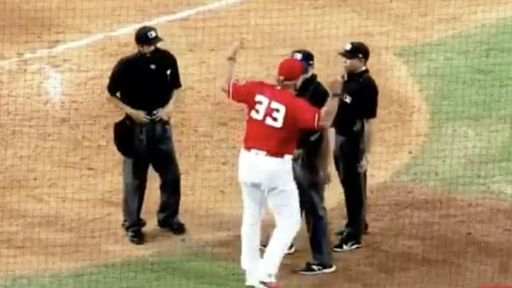 Louisville Bats manager Pat Kelly argues with umpires in various states of undress.