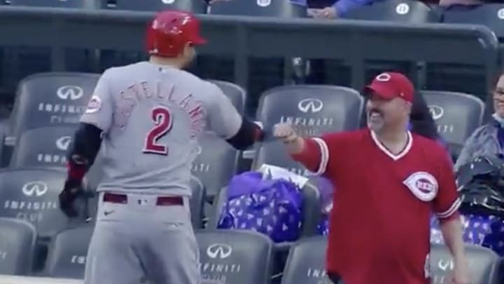 Nick Castellanos fist bumps a Reds fan in Denver.