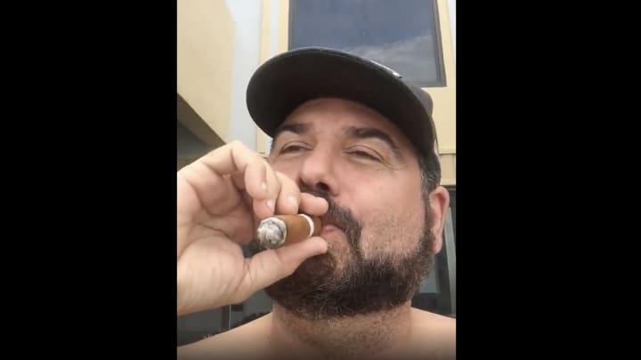 Dan Le Batard smoking a cigar for the laughs.