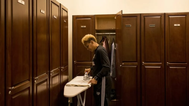 New York Liberty coach and former WNBA basketball player, Teresa Weatherspoon, irons her clothes before Game 1 of the Eastern Conference Finals.