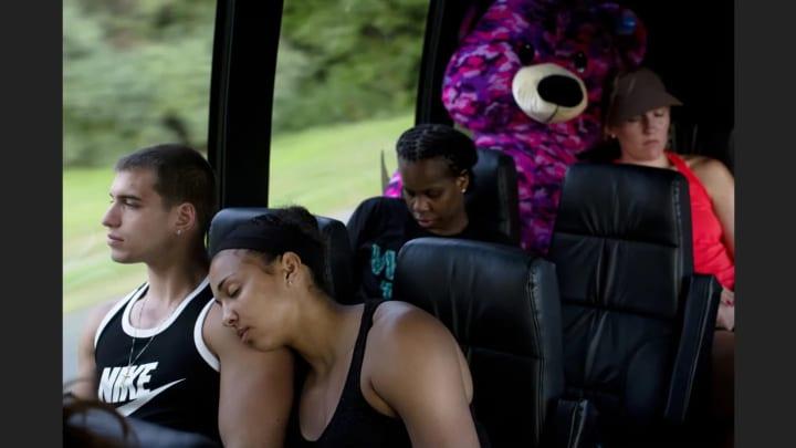 The team sleeps on the bus on the way home.