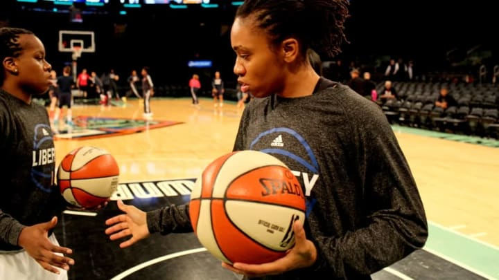 Epiphanny Prince and Tanisha Wright warm up before the game.