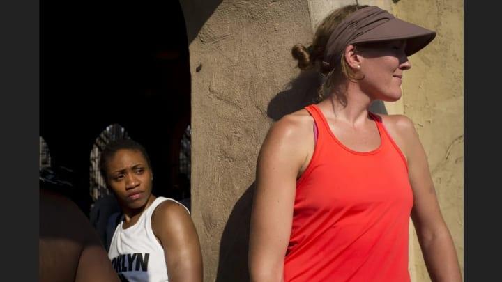 Tanisha Wright and Carolyn Swords wait in line.