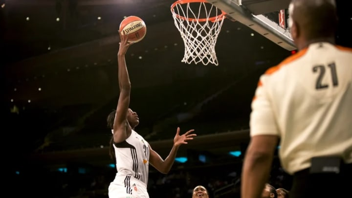 Tina Charles scores during game three of the semi-final round.