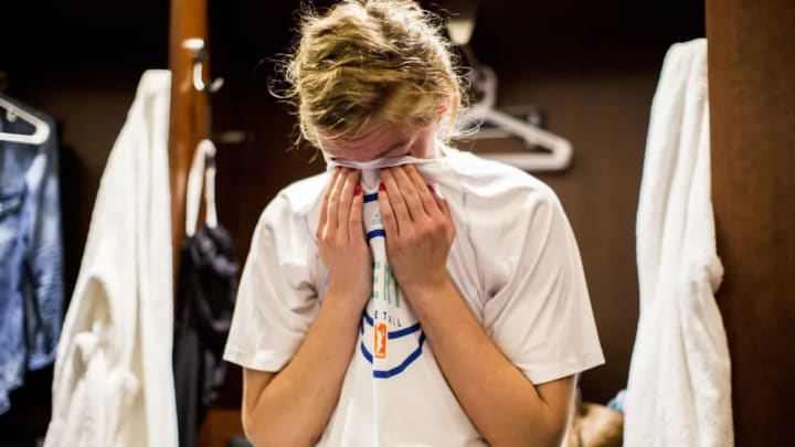 Carolyn Swords wipes her eyes in the locker room after their loss to the Indiana Fever in Game 3 of the Eastern Conference Finals.