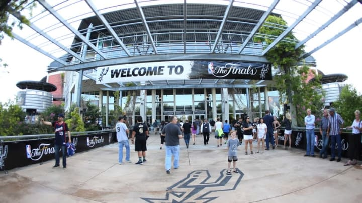 Jun 8, 2014; San Antonio, TX, USA; Fans enter the stadium prior to the game with the San Antonio Spurs playing against the Miami Heat in game two of the 2014 NBA Finals at AT&T Center. Mandatory Credit: Soobum Im-USA TODAY Sports