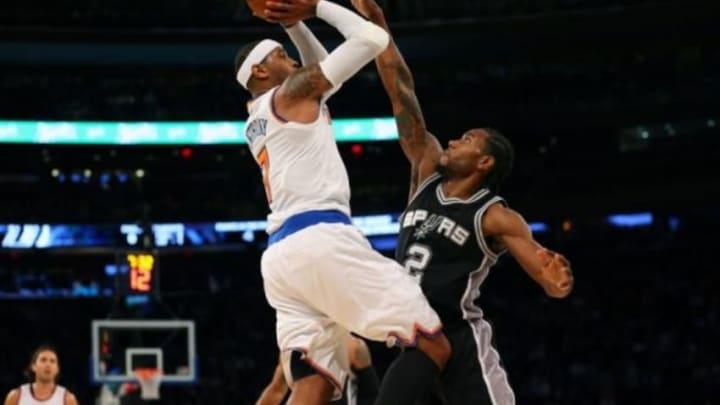 Nov 2, 2015; New York, NY, USA; New York Knicks forward Carmelo Anthony (7) shoots over San Antonio Spurs forward Kawhi Leonard (2) during the first quarter at Madison Square Garden. Mandatory Credit: Anthony Gruppuso-USA TODAY Sports