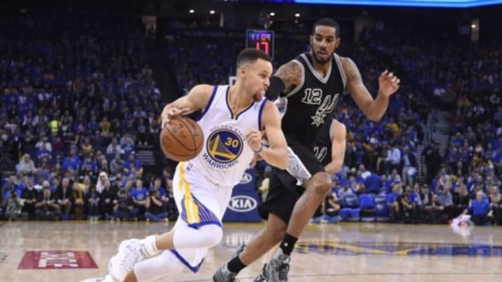 January 25, 2016; Oakland, CA, USA; Golden State Warriors guard Stephen Curry (30) dribbles the basketball against San Antonio Spurs forward LaMarcus Aldridge (12) during the first quarter at Oracle Arena. Mandatory Credit: Kyle Terada-USA TODAY Sports