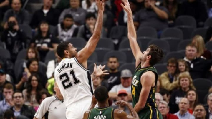 Jan 6, 2016; San Antonio, TX, USA; San Antonio Spurs power forward Tim Duncan (21) shoots the ball over Utah Jazz center Jeff Withey (24) during the first half at AT&T Center. Mandatory Credit: Soobum Im-USA TODAY Sports