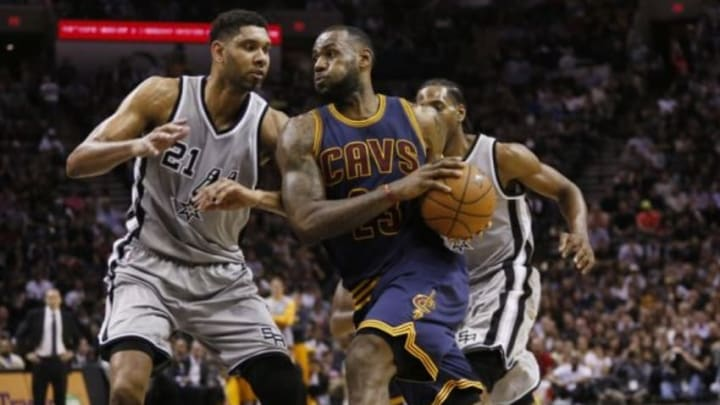 Mar 12, 2015; San Antonio, TX, USA; Cleveland Cavaliers forward LeBron James (23) drives to the basket while guarded by San Antonio Spurs power forward Tim Duncan (21) during the second half at AT&T Center. Mandatory Credit: Soobum Im-USA TODAY Sports