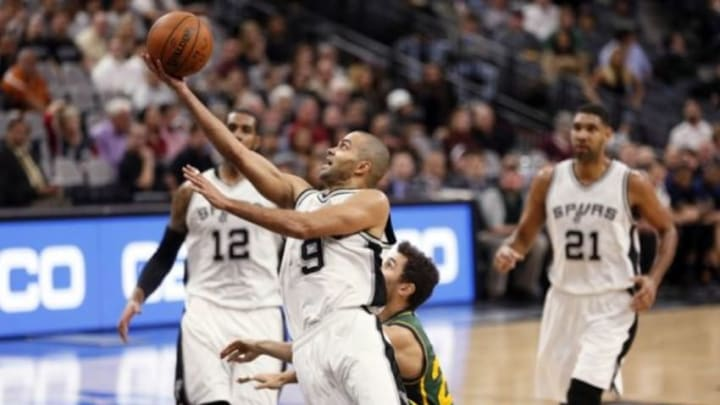 Dec 14, 2015; San Antonio, TX, USA; San Antonio Spurs point guard Tony Parker (9) shoots the ball during the second half against the Utah Jazz at AT&T Center. Mandatory Credit: Soobum Im-USA TODAY Sports