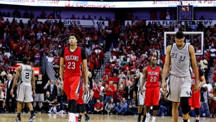 Apr 15, 2015; New Orleans, LA, USA; New Orleans Pelicans forward Anthony Davis (23) walks on the court against the San Antonio Spurs during the final seconds of the fourth quarter at the Smoothie King Center.The Pelicans won 108-103 to earn the eight seed in the Western Conference Playoffs. Mandatory Credit: Derick E. Hingle-USA TODAY Sports