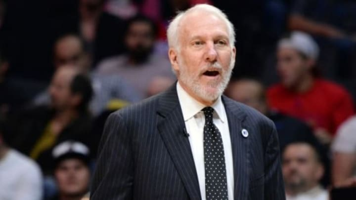 Feb 18, 2016; Los Angeles, CA, USA; San Antonio Spurs head coach Gregg Popovich talks to referees during the 2nd half against the Los Angeles Clippers at Staples Center. Mandatory Credit: Robert Hanashiro-USA TODAY Sports