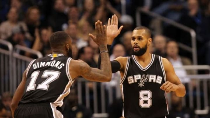 Feb 10, 2016; Orlando, FL, USA; San Antonio Spurs guard Patty Mills (8) and guard Jonathon Simmons (17) high five at the end of the first quarter against the Orlando Magic at Amway Center. Mandatory Credit: Kim Klement-USA TODAY Sports