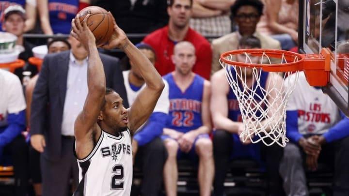 Mar 2, 2016; San Antonio, TX, USA; San Antonio Spurs small forward Kawhi Leonard (2) dunks the ball against the Detroit Pistons during the second half at AT&T Center. Mandatory Credit: Soobum Im-USA TODAY Sports