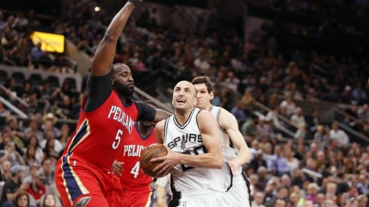 Mar 30, 2016; San Antonio, TX, USA; San Antonio Spurs shooting guard Manu Ginobili (20) drives to the basket as New Orleans Pelicans center Kendrick Perkins (5) defends during the first half at AT&T Center. Mandatory Credit: Soobum Im-USA TODAY Sports