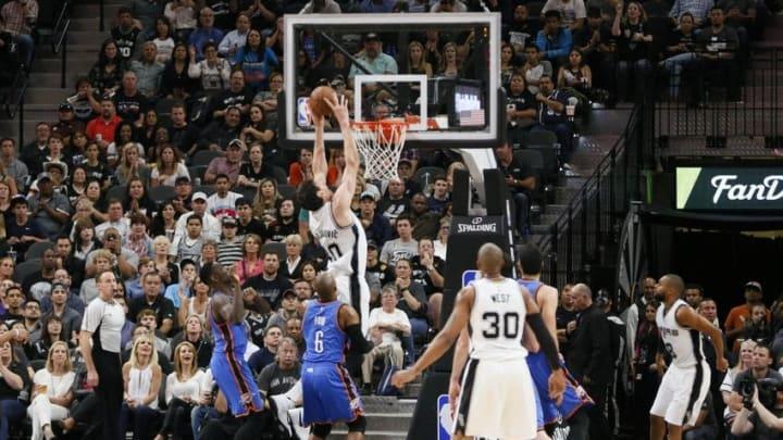 Apr 12, 2016; San Antonio, TX, USA; San Antonio Spurs center Boban Marjanovic (40) dunks the ball against the Oklahoma City Thunder during the second half at AT&T Center. Mandatory Credit: Soobum Im-USA TODAY Sports
