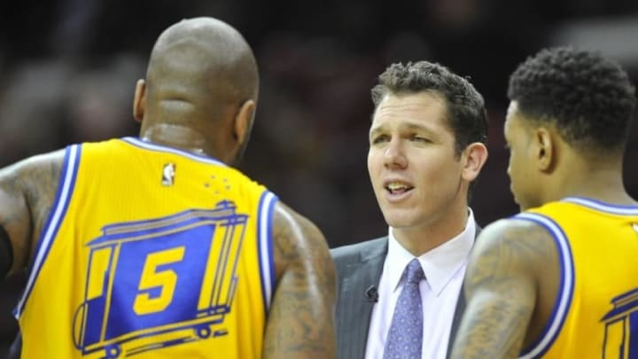 Jan 18, 2016; Cleveland, OH, USA; Golden State Warriors interim head coach Luke Walton speaks to center Marreese Speights (5) and forward Brandon Rush (4) in the fourth quarter against the Cleveland Cavaliers at Quicken Loans Arena. Mandatory Credit: David Richard-USA TODAY Sports