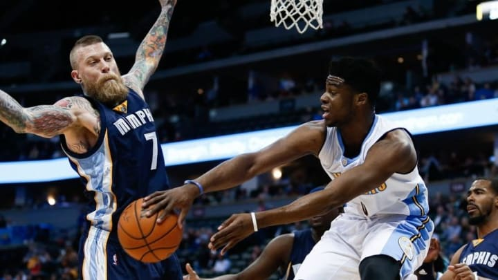 Feb 29, 2016; Denver, CO, USA; Denver Nuggets guard Emmanuel Mudiay (0) passes the ball around Memphis Grizzlies forward Chris Andersen (7) in the first quarter at the Pepsi Center. Mandatory Credit: Isaiah J. Downing-USA TODAY Sports
