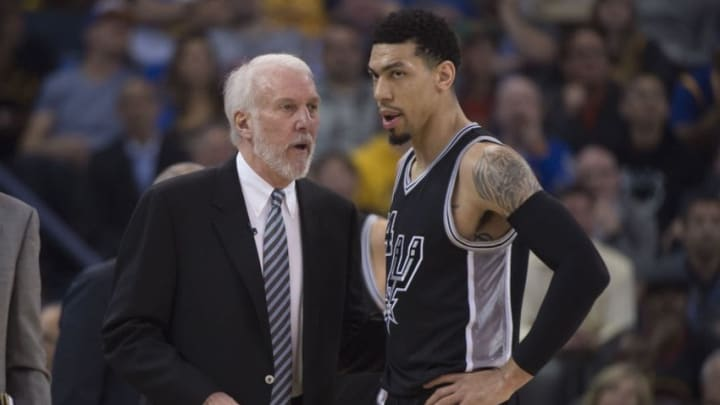 April 7, 2016; Oakland, CA, USA; San Antonio Spurs head coach Gregg Popovich (left) talks to guard Danny Green (14, right) against the Golden State Warriors during the first quarter at Oracle Arena. Mandatory Credit: Kyle Terada-USA TODAY Sports