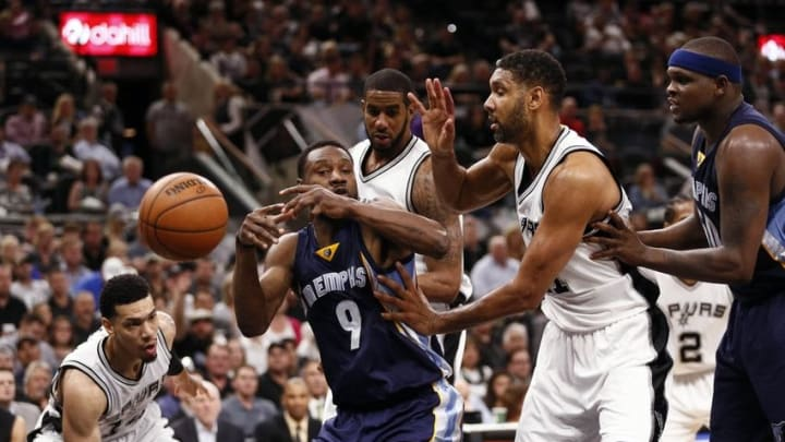 Apr 19, 2016; San Antonio, TX, USA; San Antonio Spurs shooting guard Danny Green (14, left) strips the ball from Memphis Grizzlies shooting guard Tony Allen (9) in game two of the first round of the NBA Playoffs at AT&T Center. Mandatory Credit: Soobum Im-USA TODAY Sports