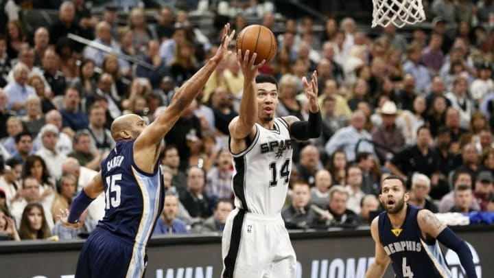 Apr 19, 2016; San Antonio, TX, USA; San Antonio Spurs shooting guard Danny Green (14) shoots the ball as Memphis Grizzlies shooting guard Vince Carter (15) defends in game two of the first round of the NBA Playoffs at AT&T Center. Mandatory Credit: Soobum Im-USA TODAY Sports