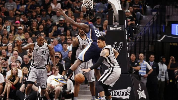 Apr 17, 2016; San Antonio, TX, USA; San Antonio Spurs shooting guard Danny Green (14, right) steals the ball from Memphis Grizzlies power forward Zach Randolph (50, top) during the first half in game one of the first round of the NBA Playoffs at AT&T Center. Mandatory Credit: Soobum Im-USA TODAY Sports
