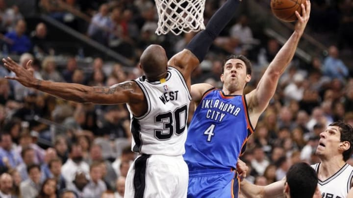 Apr 12, 2016; San Antonio, TX, USA; Oklahoma City Thunder power forward Nick Collison (4) shoots the ball as San Antonio Spurs power forward David West (30) defends during the second half at AT&T Center. Mandatory Credit: Soobum Im-USA TODAY Sports