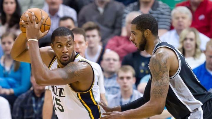 Feb 25, 2016; Salt Lake City, UT, USA; San Antonio Spurs forward LaMarcus Aldridge (12) defends against Utah Jazz forward Derrick Favors (15) during the second half at Vivint Smart Home Arena. San Antonio won 96-78. Mandatory Credit: Russ Isabella-USA TODAY Sports