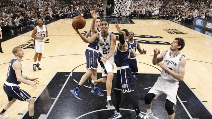 Apr 30, 2016; San Antonio, TX, USA; San Antonio Spurs guard Kevin Martin (23) shoots the ball as Oklahoma City Thunder power forward Nick Collison (4, left) and center Enes Kanter (11, right) defend in game one of the second round of the NBA Playoffs at AT&T Center. Mandatory Credit: Soobum Im-USA TODAY Sports
