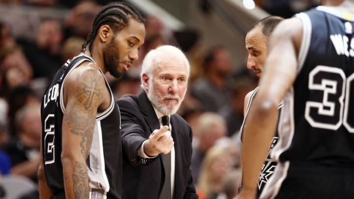 Apr 10, 2016; San Antonio, TX, USA; San Antonio Spurs head coach Gregg Popovich talks to his team during the first half against the Golden State Warriors at AT&T Center. Mandatory Credit: Soobum Im-USA TODAY Sports