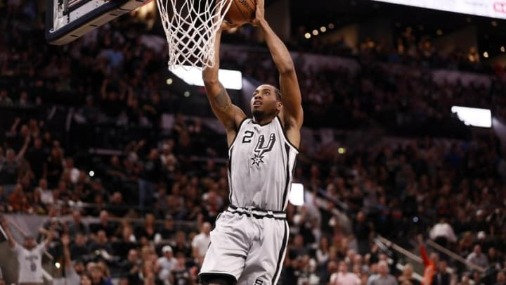 Apr 17, 2016; San Antonio, TX, USA; San Antonio Spurs small forward Kawhi Leonard (2) dunks the ball against the Memphis Grizzlies during the first half in game one of the first round of the NBA Playoffs at AT&T Center. Mandatory Credit: Soobum Im-USA TODAY Sports