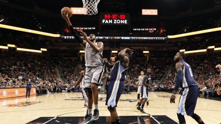 Apr 17, 2016; San Antonio, TX, USA; San Antonio Spurs power forward LaMarcus Aldridge (12, left) shoots the ball as Memphis Grizzlies power forward Zach Randolph (50, right) defends during the first half in game one of the first round of the NBA Playoffs at AT&T Center. Mandatory Credit: Soobum Im-USA TODAY Sports