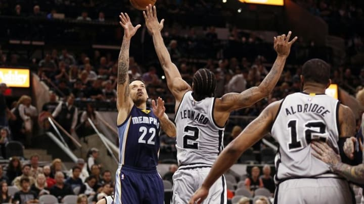 Apr 17, 2016; San Antonio, TX, USA; Memphis Grizzlies small forward Matt Barnes (22) shoots the ball over San Antonio Spurs small forward Kawhi Leonard (2) during the second half in game one of the first round of the NBA Playoffs at AT&T Center. Mandatory Credit: Soobum Im-USA TODAY Sports
